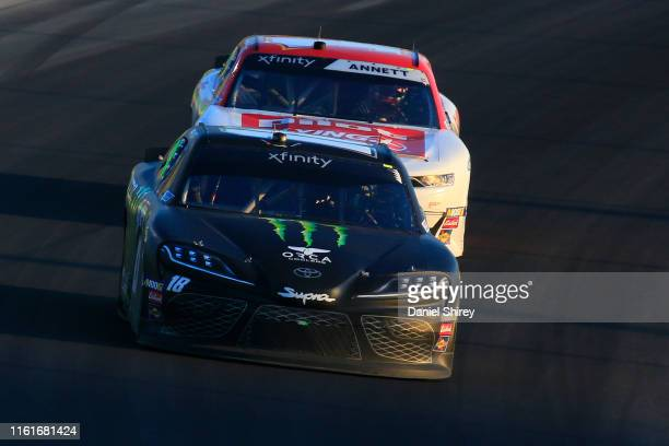Riley Herbst driver of the Monster Energy Toyota and Michael Annett driver of the Pilot/Flying J Chevrolet race during the NASCAR Xfinity Series...
