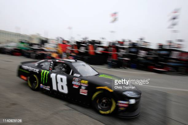 Riley Herbst driver of the Monster Energy Toyota drives through the garage during practice for the NASCAR Xfinity Series Allied Steel Buildings 200...