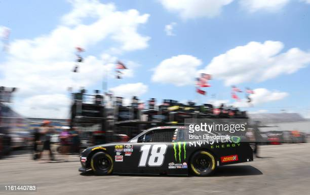 Riley Herbst driver of the Monster Energy Toyota drives through the garage area during practice for the NASCAR Xfinity Series Alsco 300 at Kentucky...