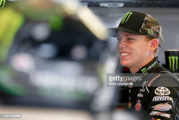 Riley Herbst driver of the Monster Energy Toyota stands by his car during practice for the NASCAR Xfinity Series Alsco 300 at Kentucky Speedway on...