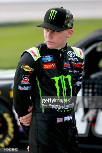 Riley Herbst driver of the Monster Energy/Advance Auto Parts Toyota stands on pit road during qualifying for the NASCAR Gander Outdoors Truck Series...