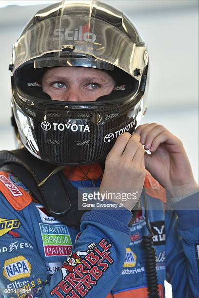 Riley Herbst driver of the NOS Energy Drink Toyota tightens his helmet before practice for the NASCAR KN Pro Series West UMC 110 presented by Ken...