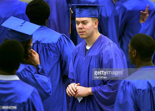 Riley Hurtado center and other incarcerated young men who are from graduating class of 2003 wait for the graduation ceremony to start at Lyle Eagan...