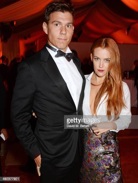 Riley Keough and Ben SmithPetersen attend the 'Foxcatcher' party hosted by Annapurna at Baoli Beach during the 67th Cannes Film Festival on May 19...