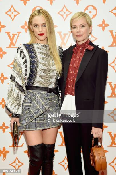 Riley Keough and Michelle Williams attend the Louis Vuitton X Grace Coddington Event on October 25 2018 in New York City