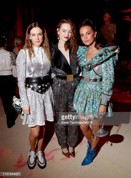 Riley Keough Emma Stone and Alicia Vikander attend The 2019 Met Gala Celebrating Camp Notes on Fashion at Metropolitan Museum of Art on May 06 2019...