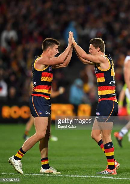 Riley Knight and Matt Crouch of the Crows celebrate after the final siren during the round 18 AFL match between the Adelaide Crows and the Geelong...