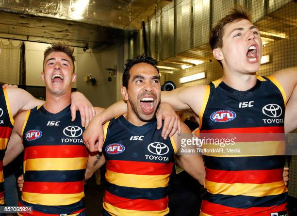 Riley Knight Eddie Betts and Jake Kelly of the Crows sing the team song during the 2017 AFL First Preliminary Final match between the Adelaide Crows...