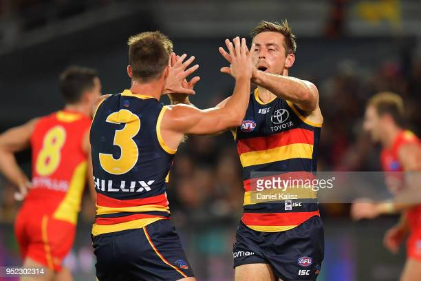 Riley Knight of the Crows and Richard Douglas of the Crows celebrate during the round six AFL match between the Adelaide Crows and Gold Coast Suns at...
