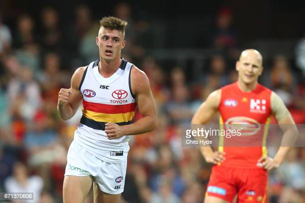 Riley Knight of the Crows celebrates a goal while Gary Ablett of the Suns looks on during the round five AFL match between the Gold Coast Suns and...