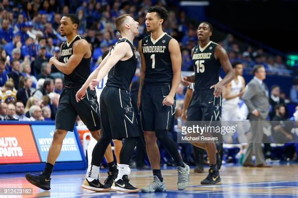 Riley LaChance of the Vanderbilt Commodores celebrates with Payton Willis after a basket against the Kentucky Wildcats during the first half at Rupp...
