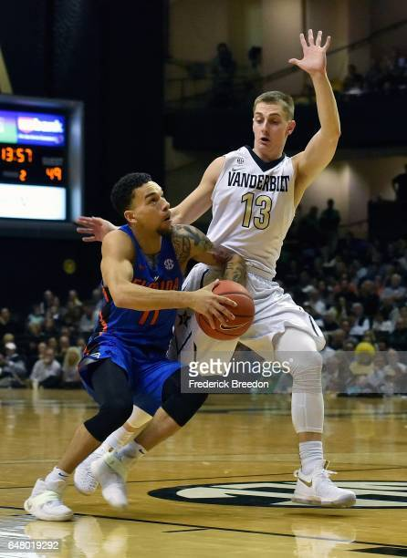 Riley Lachance of the Vanderbilt Commodores defends Chris Chiozza of the Florida Gators during the second half of a 7371 Vanderbilt upset over...