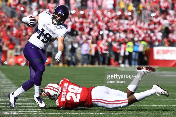 Riley Lees of the Northwestern Wildcats avoids a tackle by Dontye CarriereWilliams of the Wisconsin Badgers during a game at Camp Randall Stadium on...