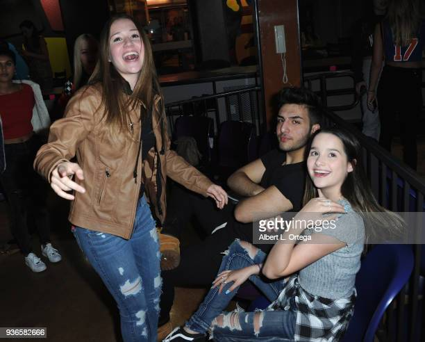 Riley Lewis Greg Marks and Annie LeBlanc attend the Birthday Party For Elam Roberson held at Pinz Bowling on March 21 2018 in Los Angeles California