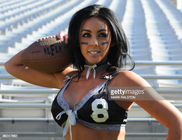 Riley Maddex poses for photographers before training with other members of the Lingerie Football League team called the Los Angeles Temptation at the...