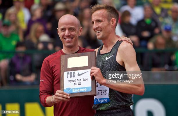Riley Masters of the USA poses with Alan Webb of the USA after becoming the 500th person to run a sub 4:00 mile during the 2018 Prefontaine Classic...