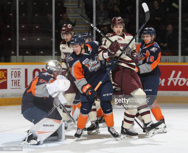 Riley McCourt of the Flint Firebirds battles against Cameron Butler of the Peterborough Petes in an OHL game at the Peterborough Memorial Centre on...