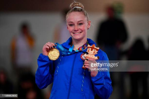 Riley McCusker poses with her gold medal after winning the Artistic Gymnastics Women's Uneven Bars Final during the Lima 2019 Pan-American Games in...