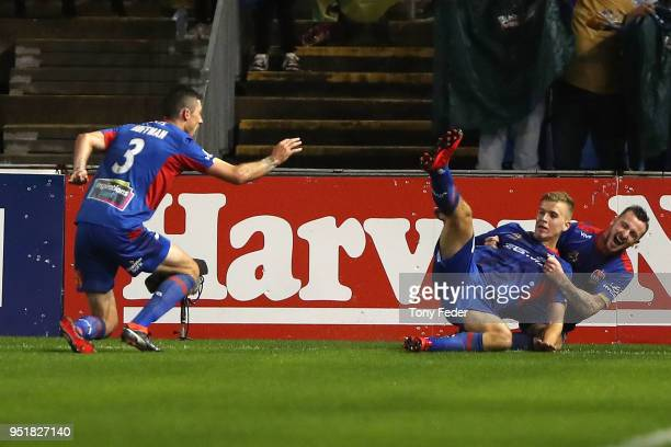 Riley McGree and Roy O'Donovan of the Jets celebrate a goal during the ALeague Semi Final match between the Newcastle Jets and Melbourne City at...