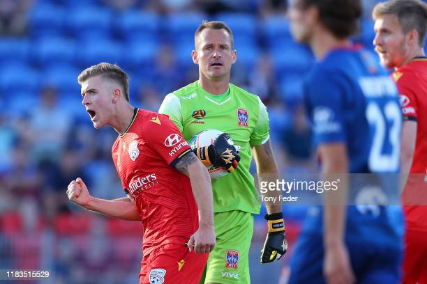 Riley Mcgree of Adelaide United celebrates a goal during the round three A-League match between the Newcastle Jets and Adelaide United at McDonald...