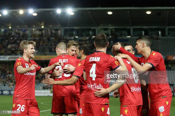 Riley Mcgree of Adelaide United celebrates his goal with team mates during the FFA Cup 2019 Semi Final between the Central Coast Mariners and...