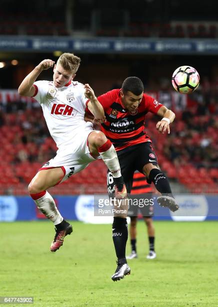 Riley McGree of Adelaide United competes for the ball against Jaushua Sotirio of the Wanderers during the round 22 ALeague match between the Western...