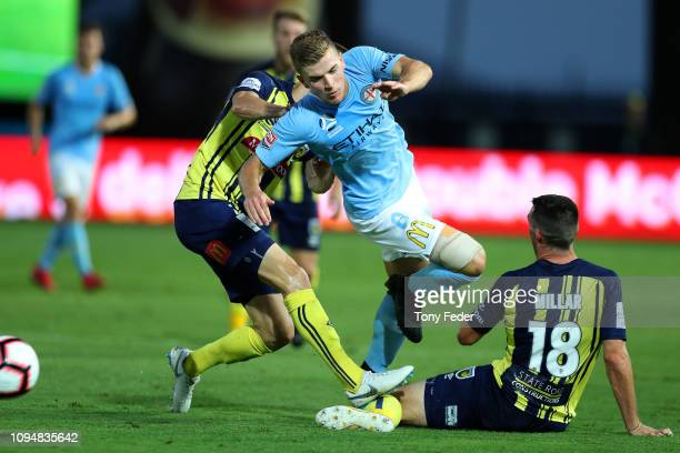 Riley McGree of Melbourne City is tackled during the round 12 ALeague match between the Central Coast Mariners and Melbourne City FC at Central Coast...