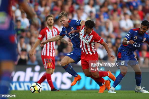 Riley McGree of the Jets and Daniel Arzani contest the ball during the round 25 ALeague match between the Newcastle Jets and Melbourne City at...