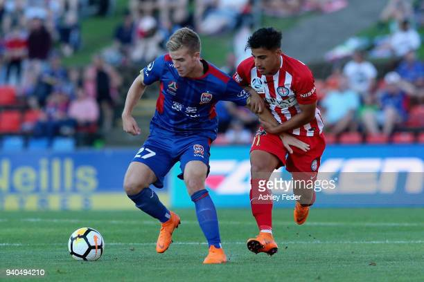 Riley McGree of the Jets contests the ball against Daniel Arzani of Melbourne City during the round 25 ALeague match between the Newcastle Jets and...