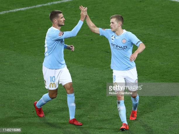 Riley McGree of the Melbourne City celebrates with Dario Vidosic after scoring a goal during the round 27 ALeague match between Melbourne City and...