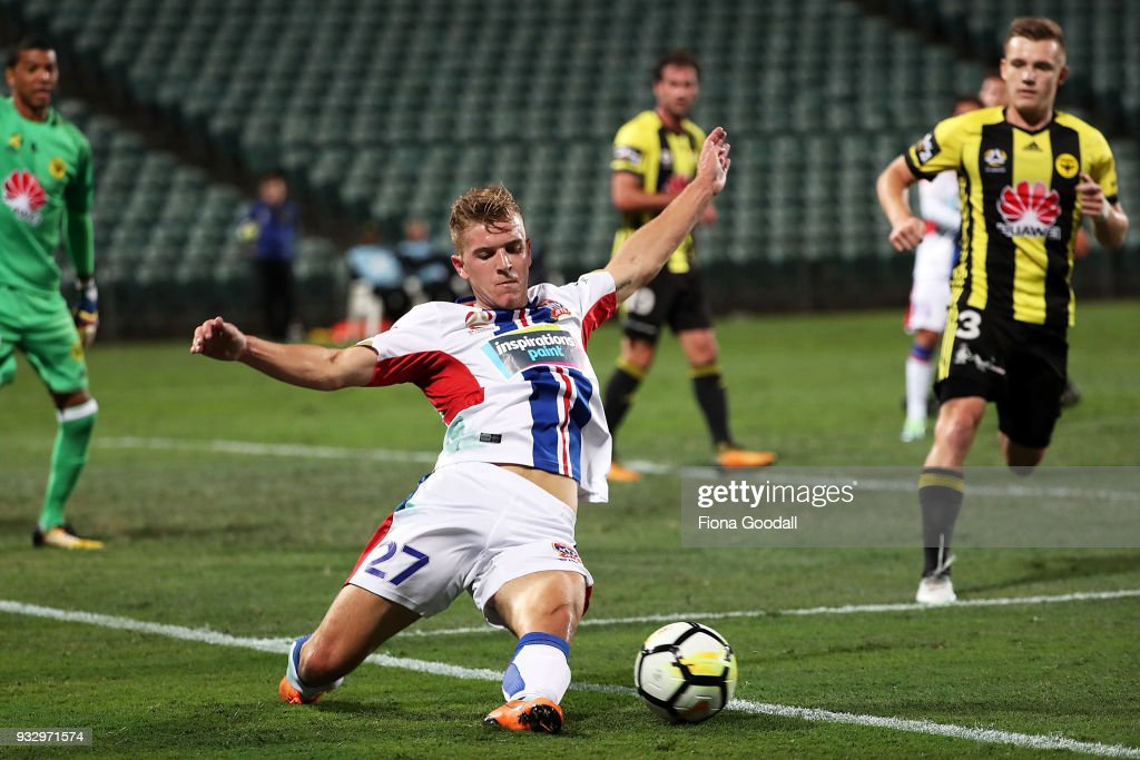 Riley McGree of the Newcastle Jets slides for the ball during the round 23 A-League match between the Wellington Phoenix and the Newcastle Jets at QBE Stadium on March 17, 2018 in Auckland, New Zealand.