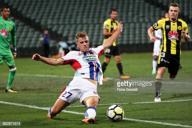 Riley McGree of the Newcastle Jets slides for the ball during the round 23 ALeague match between the Wellington Phoenix and the Newcastle Jets at QBE...
