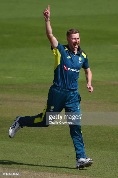 Riley Meredith of team Finch XI celebrates after taking the wicket of team Cummins XI Steve Smith during the 50 over Australia Inter-Squad Warm Up...