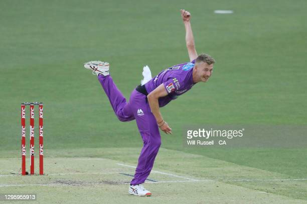 Riley Meredith of the Hurricanes bowls during the Big Bash League match between the Perth Scorchers and the Hobart Hurricanes at Optus Stadium, on...