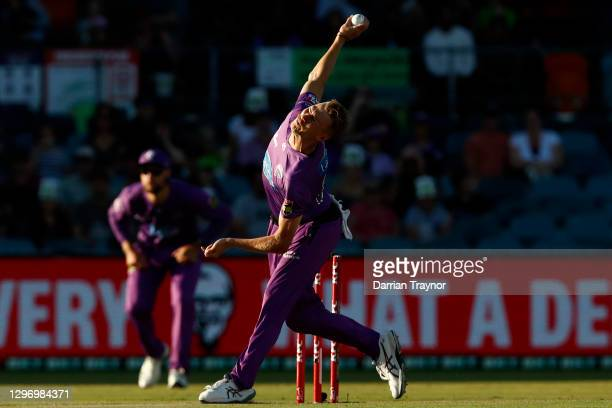 Riley Meredith of the Hurricanes bowls during the Big Bash League match between the Sydney Thunder and the Hobart Hurricanes at Manuka Oval, on...