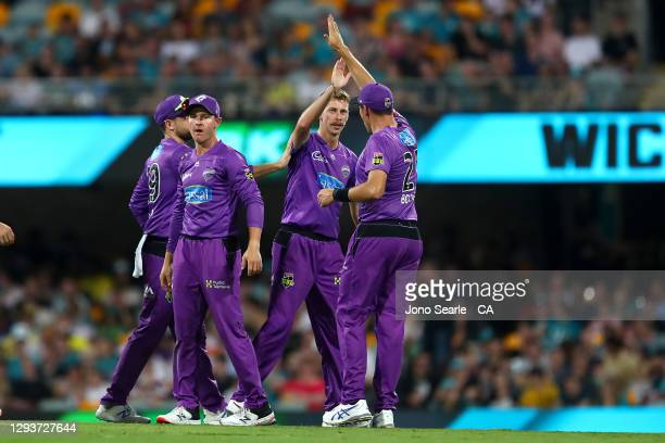 Riley Meredith of the Hurricanes celebrates a wicket during the Big Bash League match between the Hobart Hurricanes and Brisbane Heat at The Gabba,...