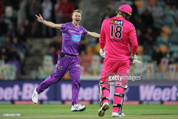 Riley Meredith of the Hurricanes celebrates taking the wicket of Jack Edwards of the Sixers during the Big Bash League match between the Hobart...
