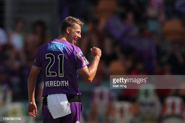 Riley Meredith of the Hurricanes celebrates taking the wicket of Rashid Khan of the Strikers during the Big Bash League match between the Adelaide...