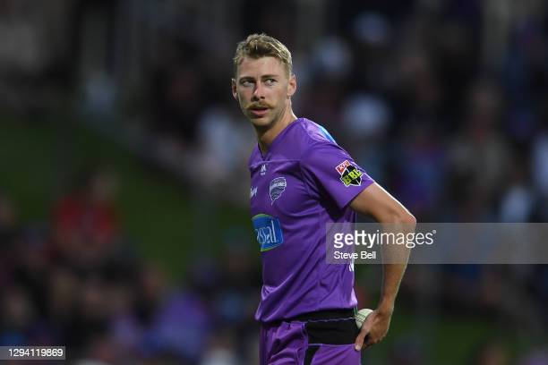 Riley Meredith of the Hurricanes prepares to bowl during the Big Bash League match between the Hobart Hurricanes and the Melbourne Stars at...