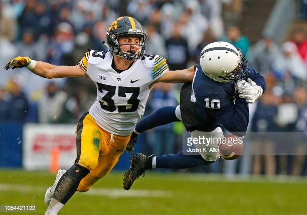 Riley Moss of the Iowa Hawkeyes breaks up a pass to Brandon Polk of the Penn State Nittany Lions on October 27 2018 at Beaver Stadium in State...