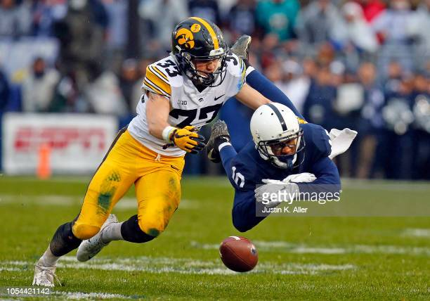 Riley Moss of the Iowa Hawkeyes breaks up a pass to Brandon Polk of the Penn State Nittany Lions on October 27, 2018 at Beaver Stadium in State...