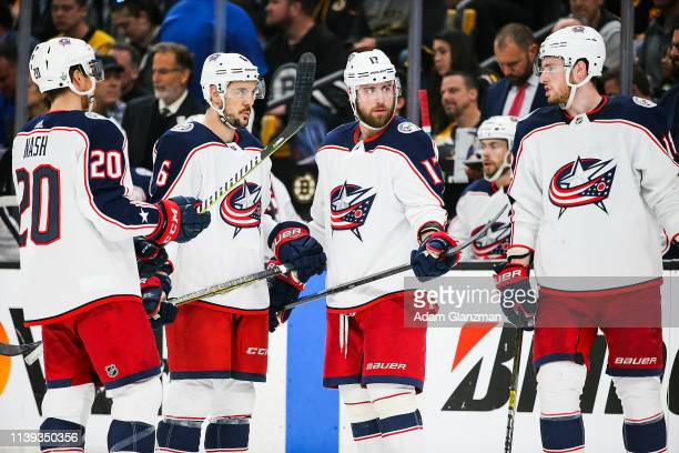 Riley Nash Brandon Dubinsky and Adam Clendening of the Columbus Blue Jackets look on in Game One of the Eastern Conference Second Round against the...