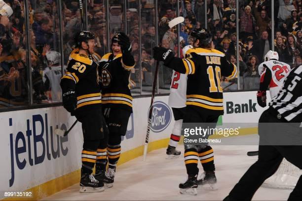 Riley Nash Danton Heinen and Anders Bjork of the Boston Bruins celebrate a second period goal against the Ottawa Senators at the TD Garden on...