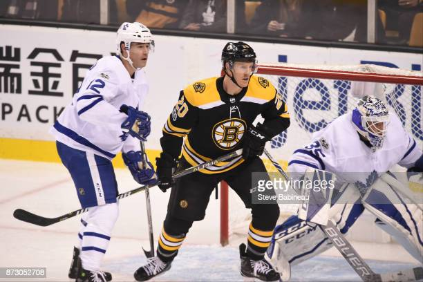 Riley Nash of the Boston Bruins against Patrick Marleau and Curtis McElhinney of the Toronto Maple Leafs at the TD Garden on November 11 2017 in...