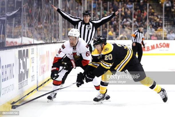 Riley Nash of the Boston Bruins and Mark Stone of the Ottawa Senators battle for control of the puck during the second period at TD Garden on April 6...