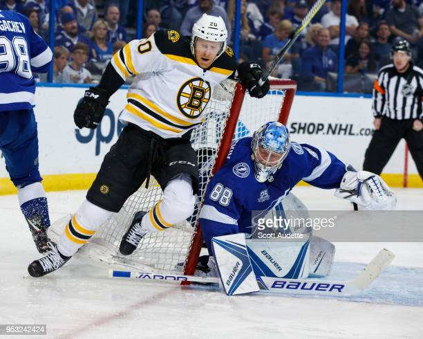 Riley Nash of the Boston Bruins falls onto the net of goalie Andrei Vasilevskiy of the Tampa Bay Lightning during Game Two of the Eastern Conference...