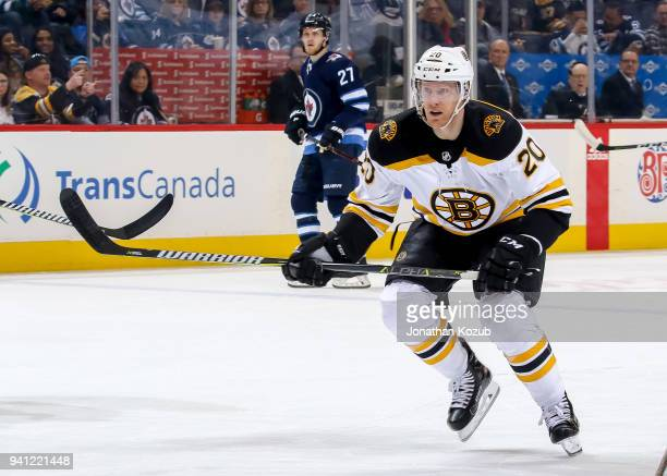 Riley Nash of the Boston Bruins follows the play down the ice during first period action against the Winnipeg Jets at the Bell MTS Place on March 27...