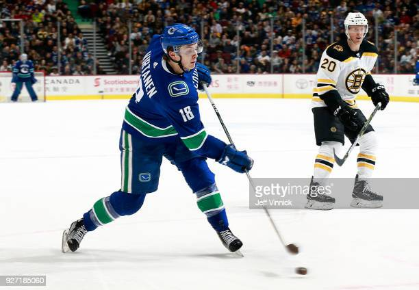 Riley Nash of the Boston Bruins looks on as Jake Virtanen of the Vancouver Canucks takes a shot during their NHL game at Rogers Arena February 17...