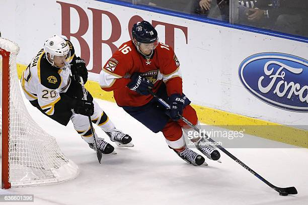 Riley Nash of the Boston Bruins pursues Aleksander Barkov of the Florida Panthers as he clears the puck from behind the net at the BBT Center on...