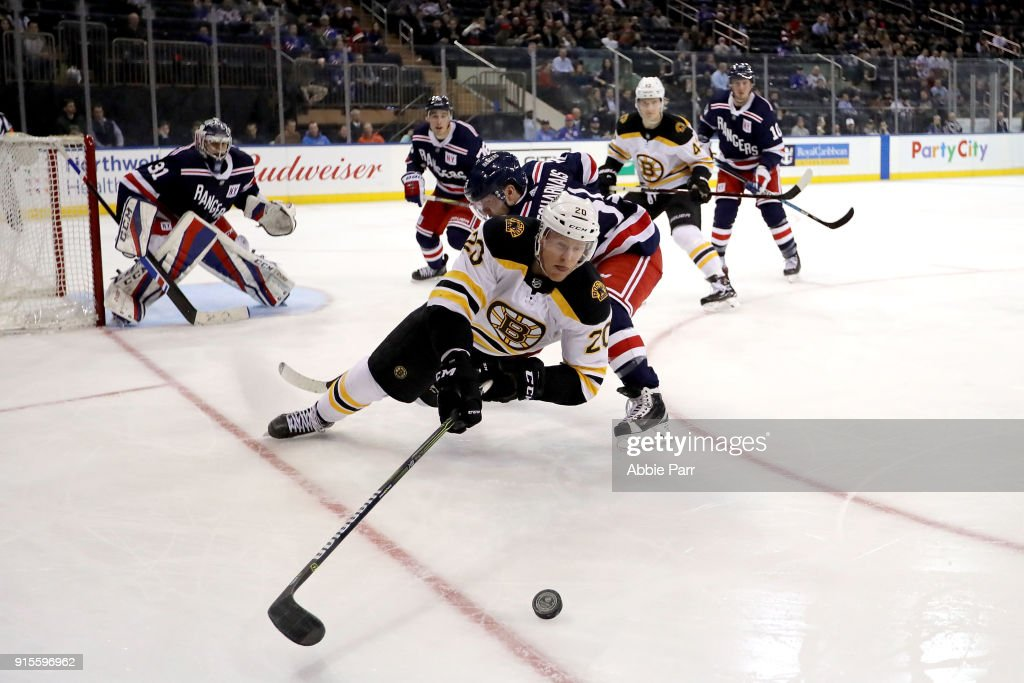 Riley Nash #20 of the Boston Bruins reaches for the puck against the New York Rangers in the third period at Madison Square Garden on February 7, 2018 in New York City.